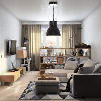 Зонирование комнаты с помощью невысокого стеллажа