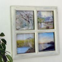 Деревянное окошко с рисунками вместо стекол