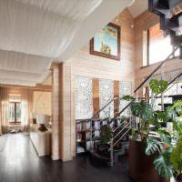 Интерьер холла с маршевой лестницей