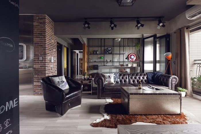 Кожаная мебель в интерьере гостиной индустриального стиля