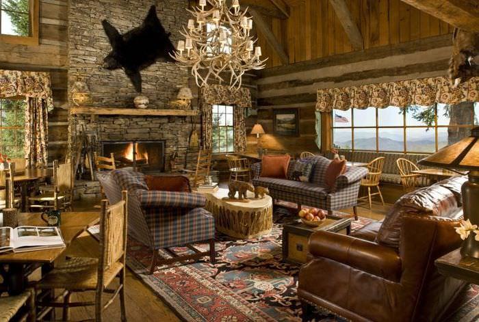Оформление гостиной в деревянном доме в охотничьем стиле