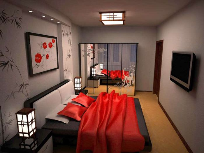 Красное покрывало в спальне с серыми стенами