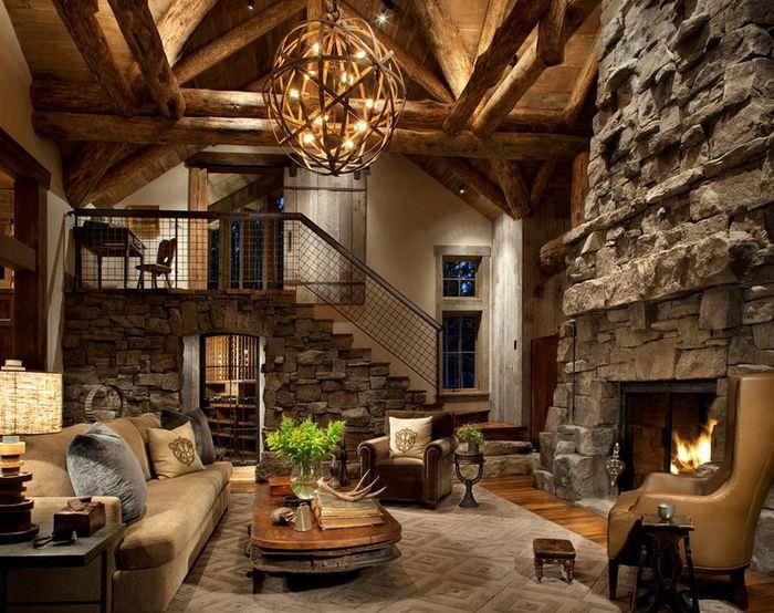 Гостиная с большим камином из природного камня
