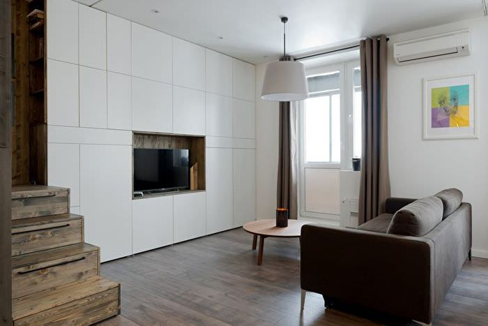 Встроенная мебель в гостиной минималистического стиля