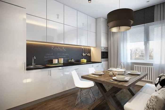 Необычный светильник в интерьере модной кухни