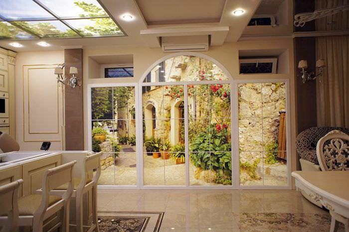 Окно-обманка с перспективой в интерьере небольшой кухни-гостиной