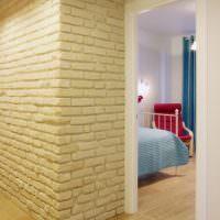 Отделка стены декоративным камнем под кирпич