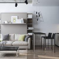 Интерьер квартиры-студии с черной кухней