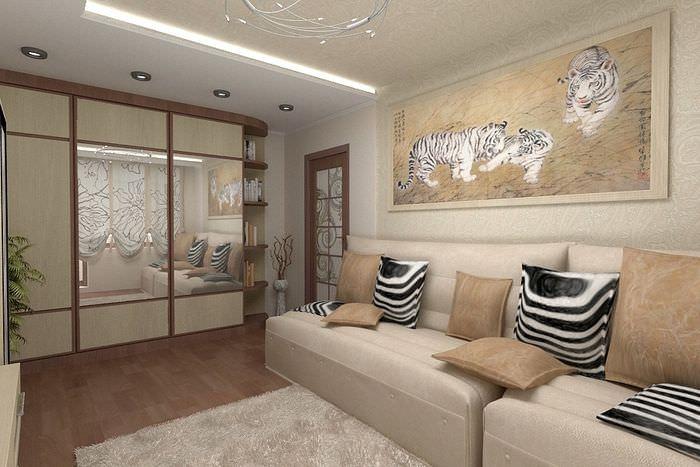 Картина с тиграми над диваном в бежевой гостиной