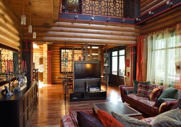 Телевизионная стойка в гостиной срубового дома