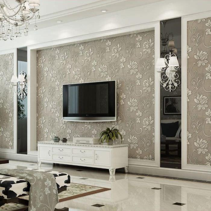 Черный телевизор на стене с бежевыми обоями