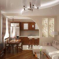 Дизайн кухни-гостиной с аркой