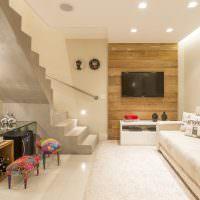 Дизайн гостиной с бетонной лестницей