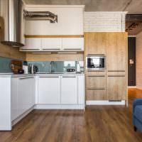 Рабочая зона с угловой планировкой в кухне-гостиной