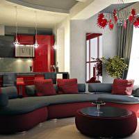 Красный цвет в оформлении кухни-гостиной