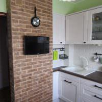 Кирпичная перегородка в интерьере кухни