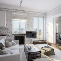 Интерьер квартиры-студии с кирпичными стенами