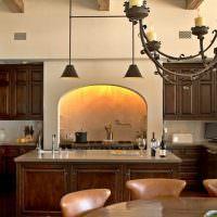 Арочная вытяжка в интерьере кухни-гостиной
