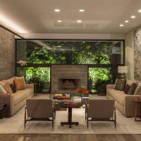 Дизайн большой гостиной с двумя диванами