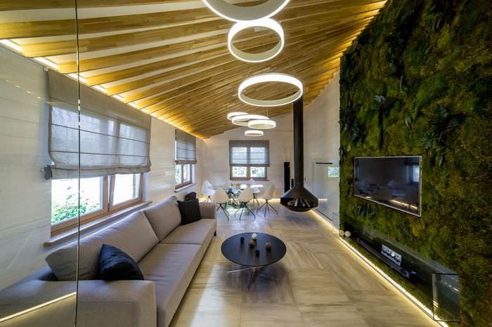 Живая стена из растений в дизайне квартиры студии