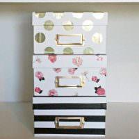 Три коробки, оклеенные подарочной бумагой