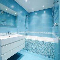 Белая подвесная тумба в ванной с голубой плиткой