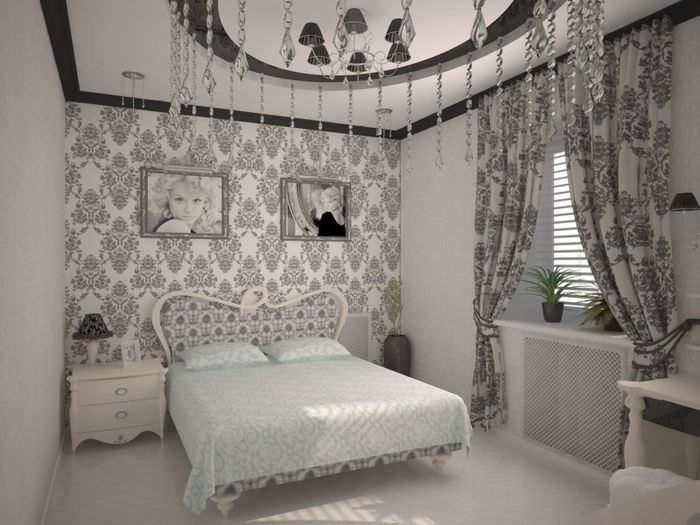 Украшение стены картинами в спальне с серыми шторами