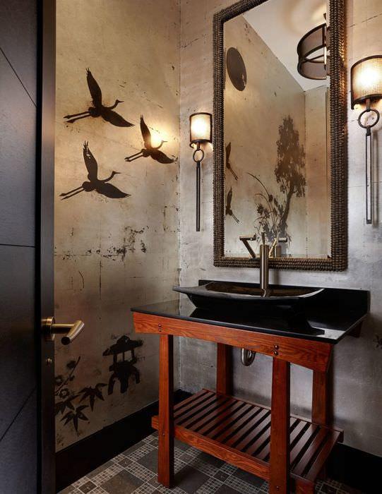 Черная раковина на деревянной подставке в ванной восточного стиля