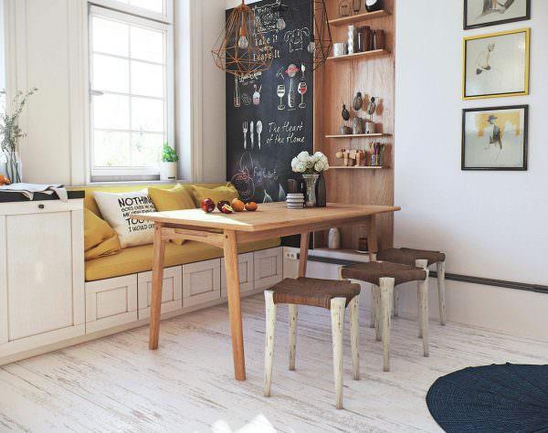 Желтый диван на кухне в скандинавском стиле