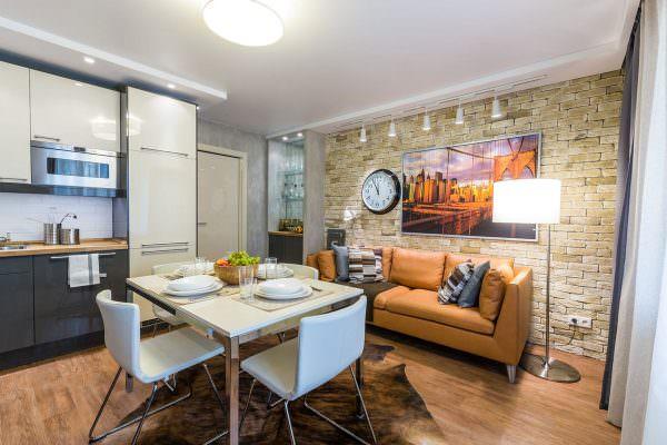 Данный стиль предполагает большое пространство и отсутствие перегородок между разными зонами. Уместно будет смотреться большой диван рядом с гарнитуром.