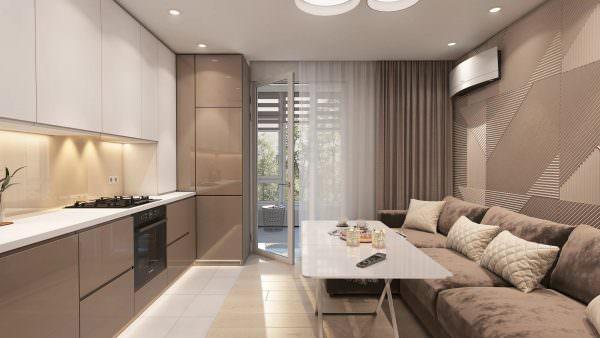 Грамотное зонирование – основополагающий фактор в данном вопросе, такой прием позволяет отделить кухню и вывести обеденную зону.
