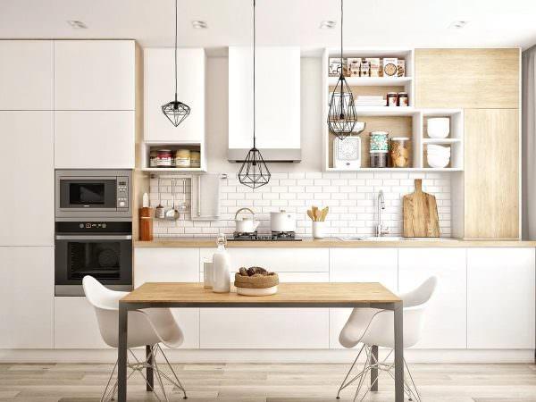 Дизайнеры рекомендуют выбирать мебель простых форм с глянцевыми или матовыми фасадами светлых оттенков.