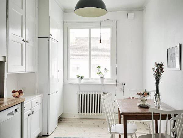 Уют и комфорт в кухне определяет оформление обеденной зоны.