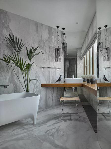 Комбинация натуральных материалов привносит жизнь в современный интерьер квартиры и может быть объединена множеством способов.