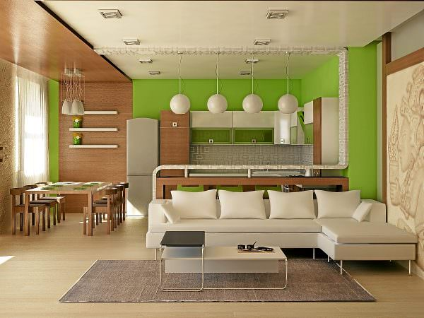 При помощи дивана выделяется гостиная. Он устанавливается спиной к рабочему участку.