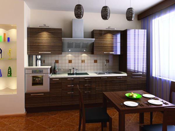 Для кухни-гостиной подойдет цвет сливового дерева или кедра, такая мебель не перегружает обстановку и выглядит нейтральной.