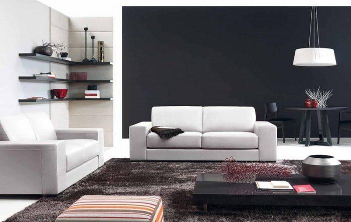 Белый диван на черном фоне